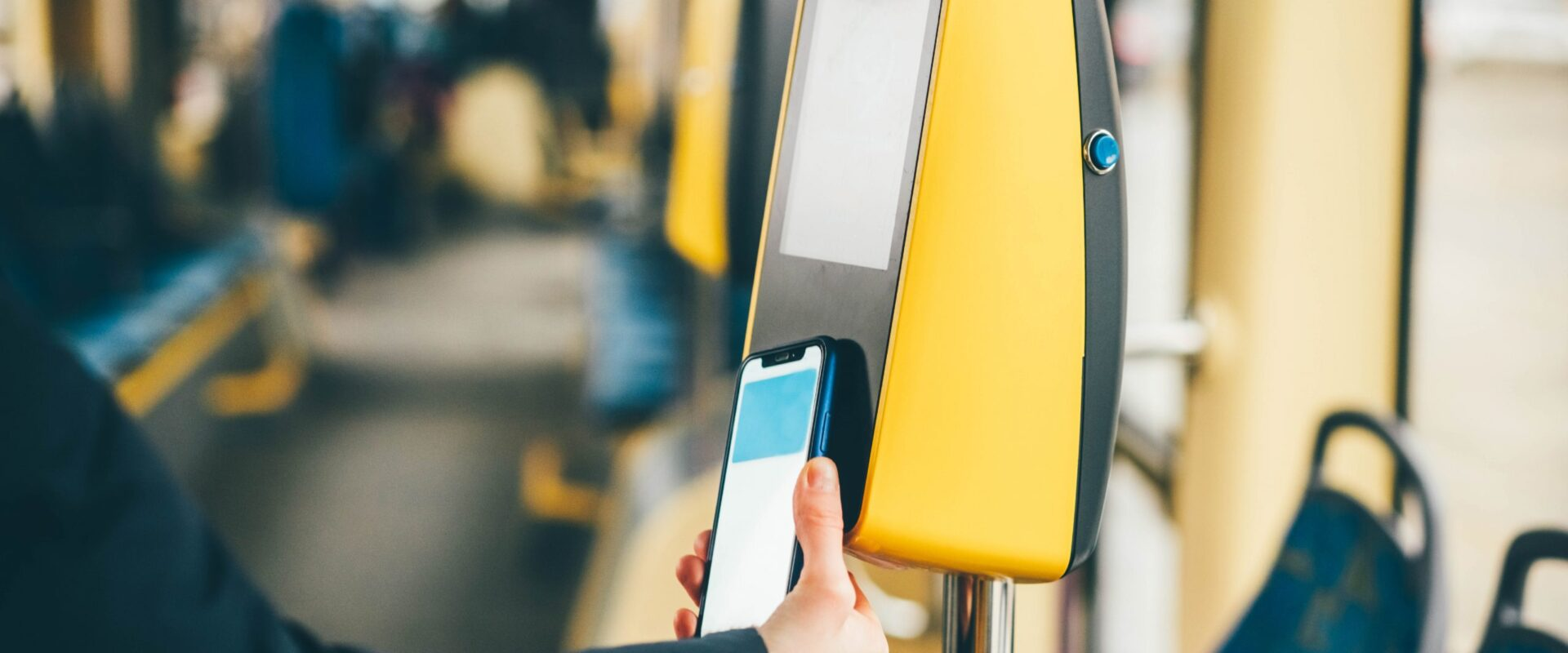 Girl paying by phone for the tram ticket. Payment by phone.
